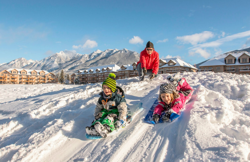Family sledding at Bighorn Meadows Resort.