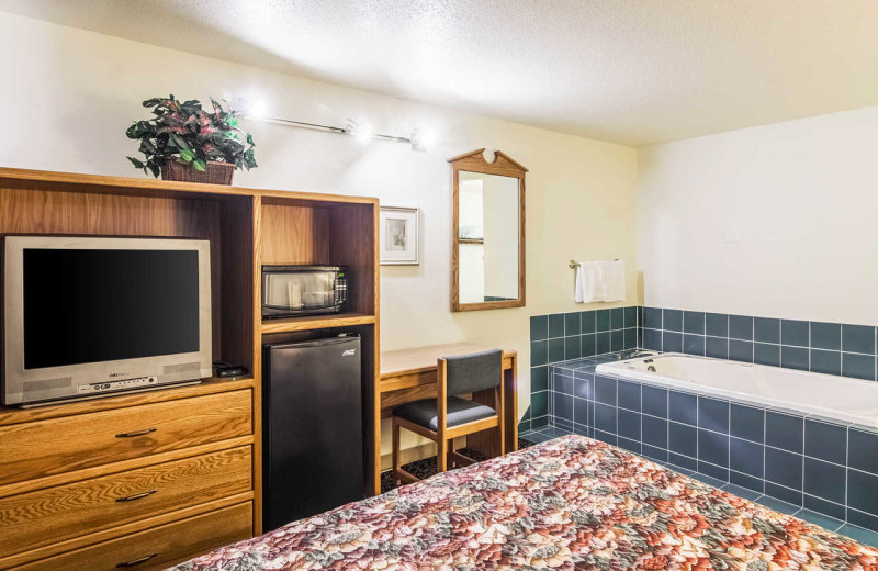 Guest room with hot tub at Rodeway Inn - Fergus Falls.