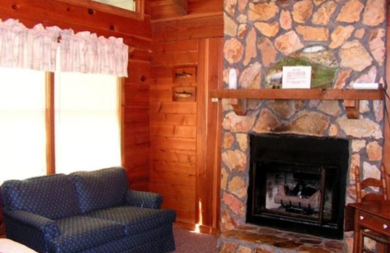 Cabin fireplace living room at Timberloft Cabin Rentals.