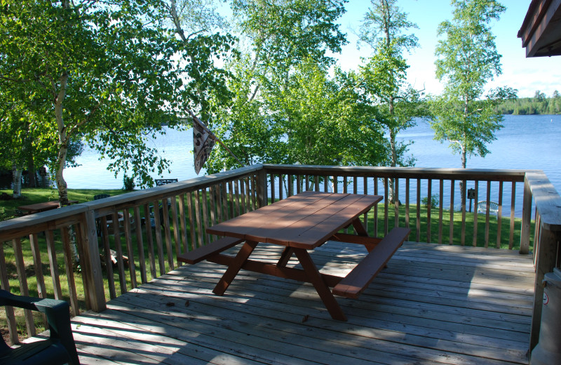 Deck with picnic table at River Point Resort & Outfitting Co.