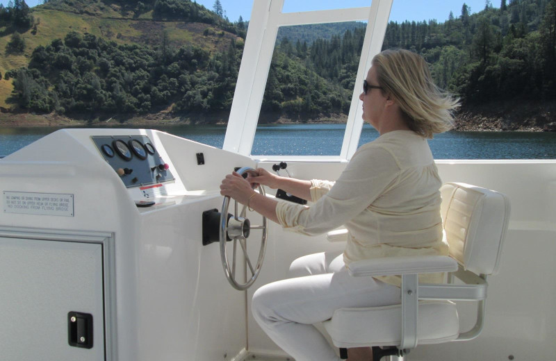 Driving the houseboat at Lake Oroville.