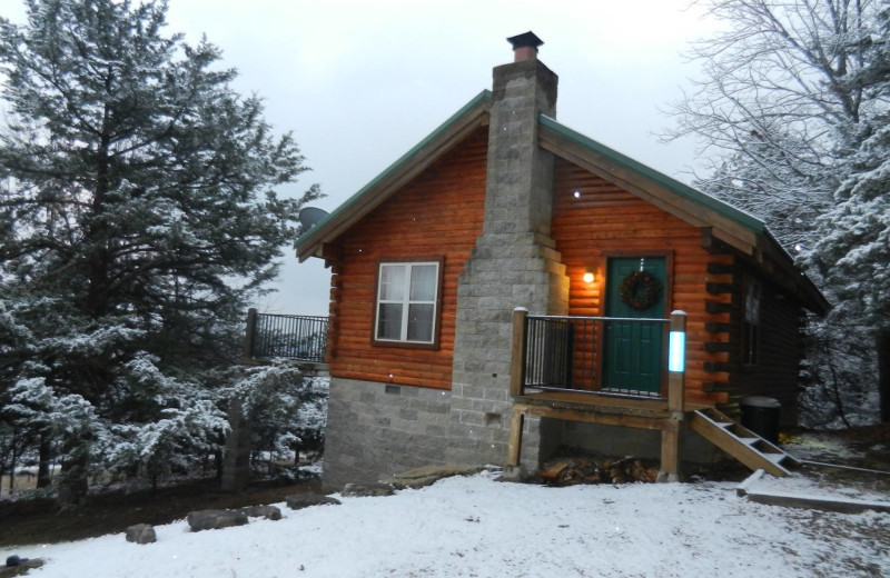Cabin in winter at Whispering Hills Cabins.