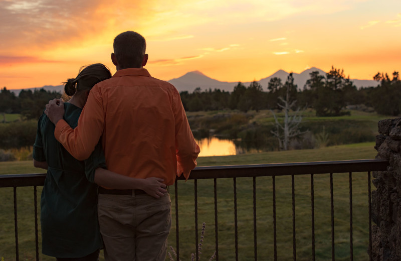 Couple on balcony at Pronghorn Resort.