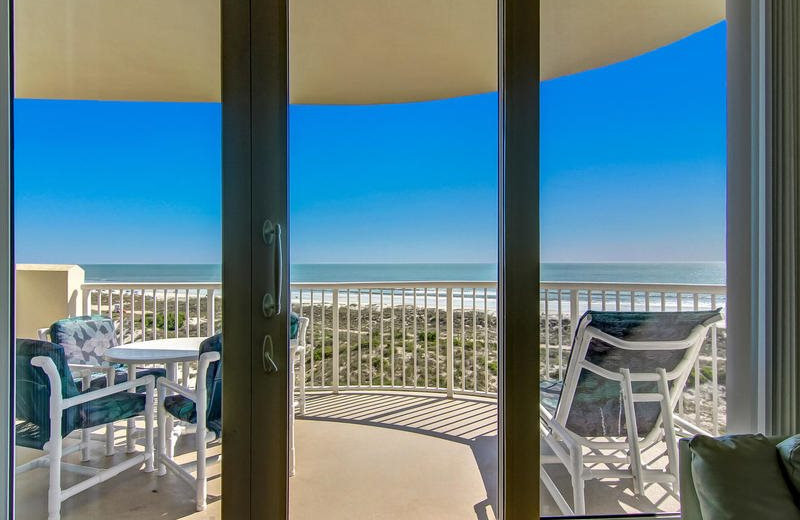 Rental balcony at Beach Vacation Rentals.