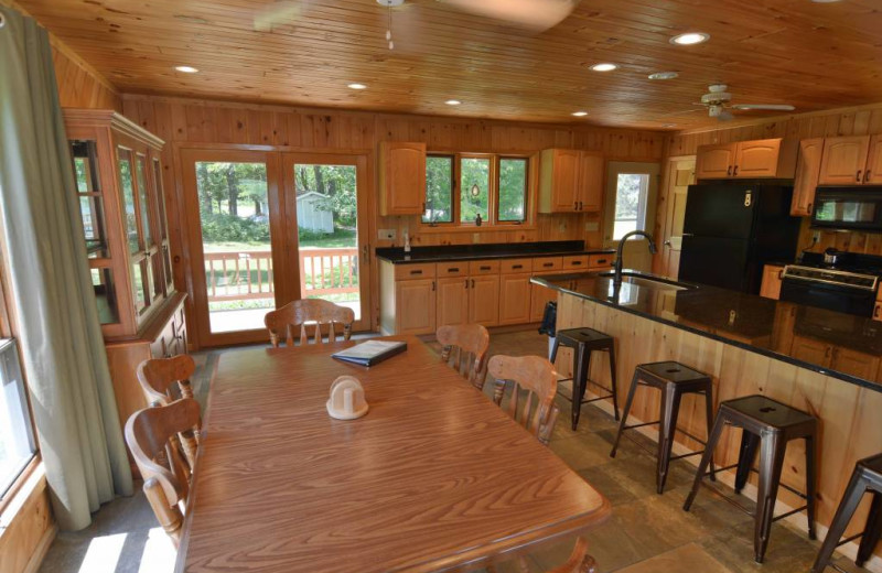Rental kitchen and dining area at Recreational Rental Properties, Inc.