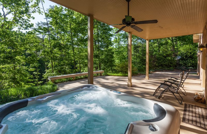 Cabin hot tub at Mountain Oasis Cabin Rentals.