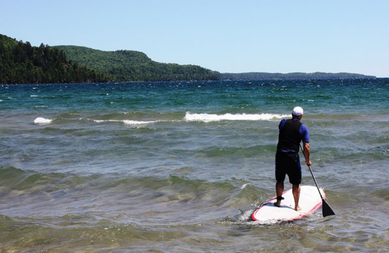 Paddle board at Aqua Log Cabin Resort.