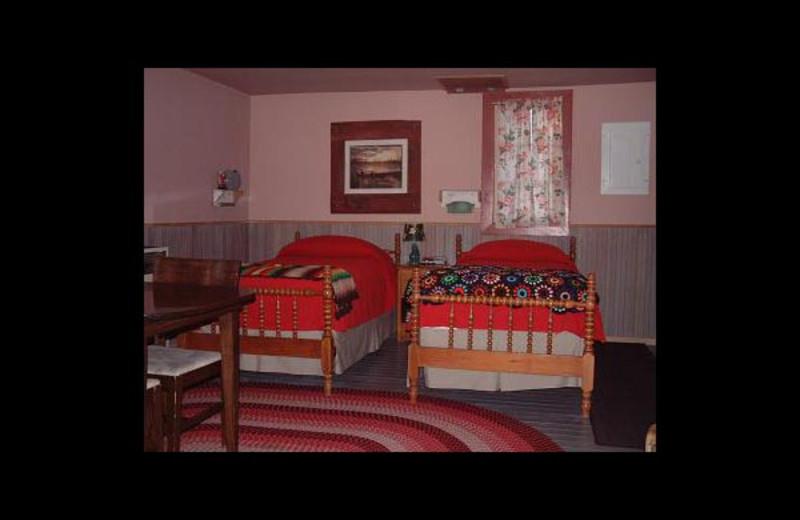 Cottage bedroom at Sandhill Cottages.