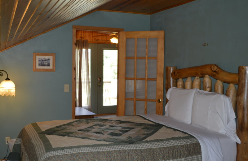Cabin bedroom at Mulberry Mountain Lodging & Events.
