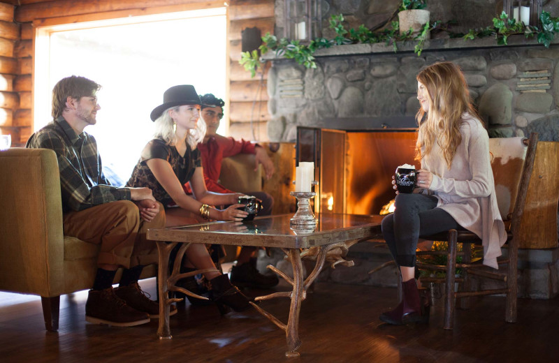 Friends gathered around a fire at Emerson Resort & Spa.