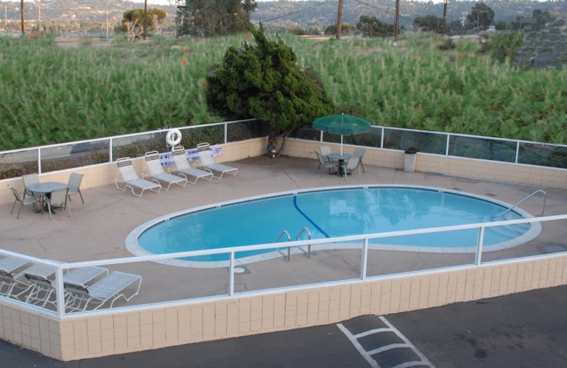 Outdoor pool at Relax Inn & Suites.
