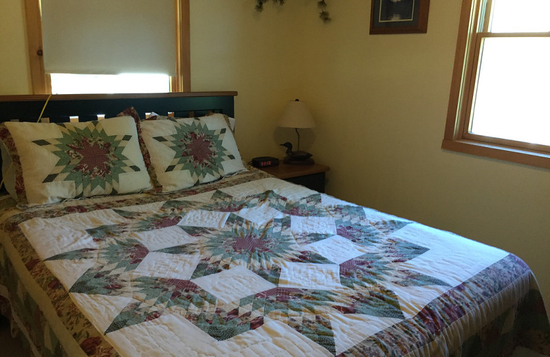Rental bedroom at Harv's Vacation Rentals.
