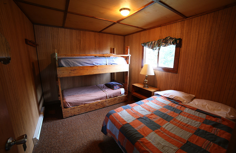 Cabin bedroom at Cliff Lake Resorts.