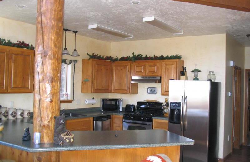 Cabin kitchen at Lori's Luxury Rentals.