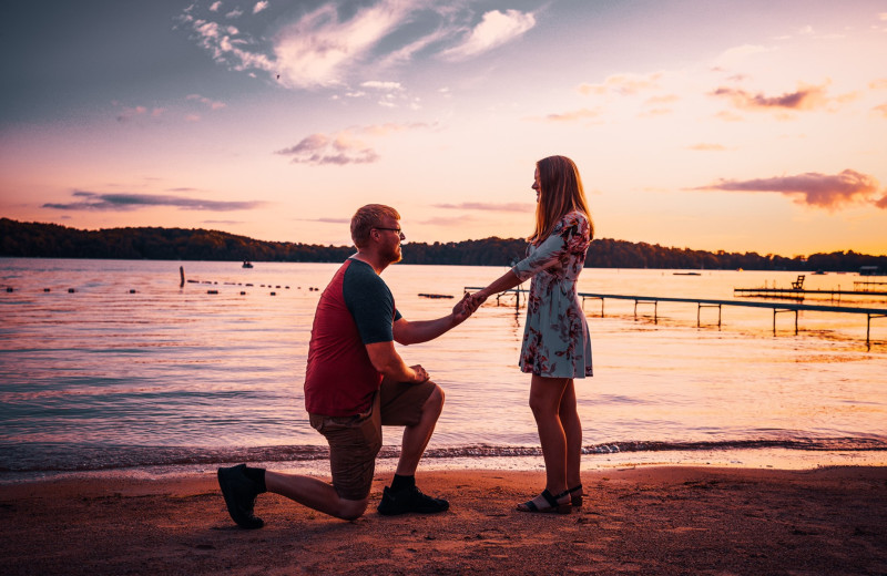 Couple proposing at The Osthoff Resort.