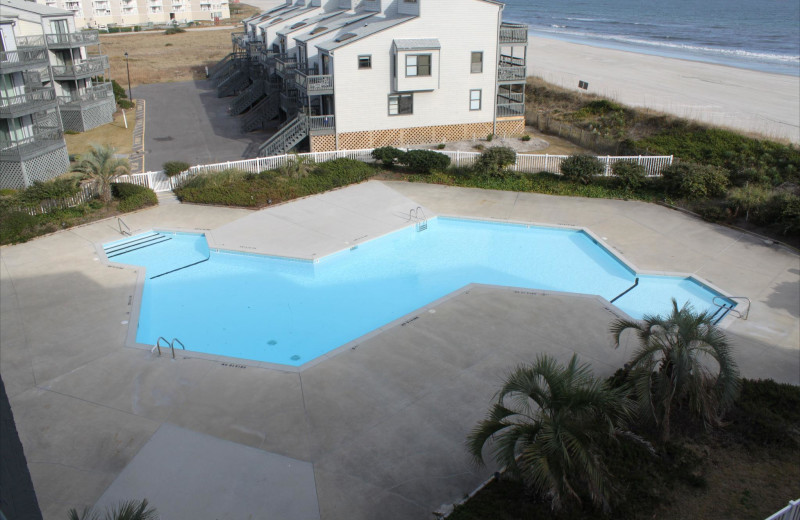 Vacation rental pool at Century 21 Action Inc.