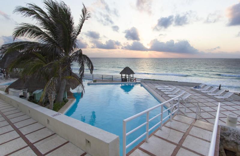 Outdoor pool at Yalmakan Cancun Hotel and Marina.