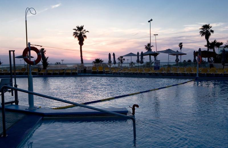 Outdoor pool at Dan Panorama Hotel.