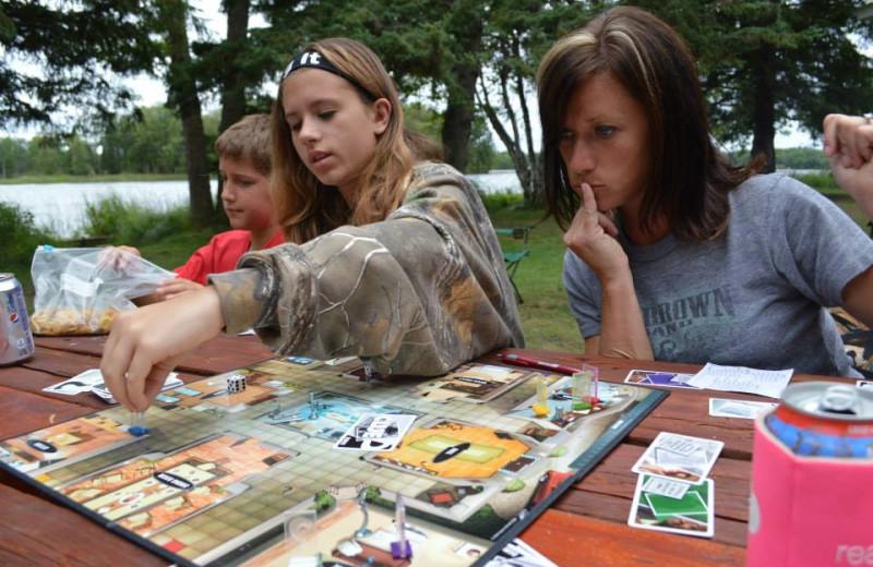 Family game night at Hyde-A-Way Bay Resort.