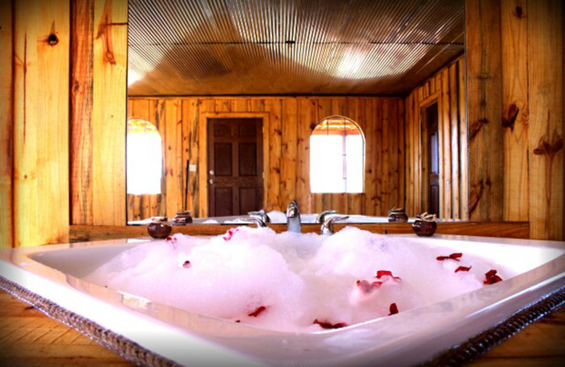 Jacuzzi view at Diamonds Old West Cabins.