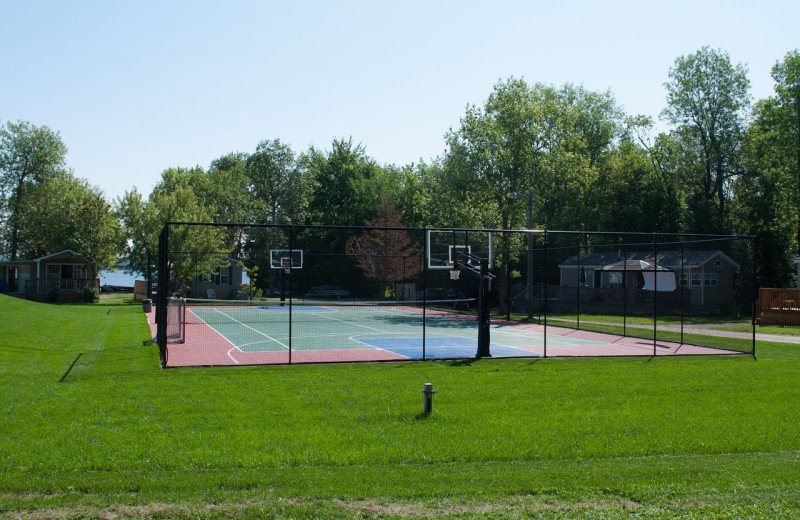 Tennis court at Great Blue Resorts- McCreary's Beach Resort.