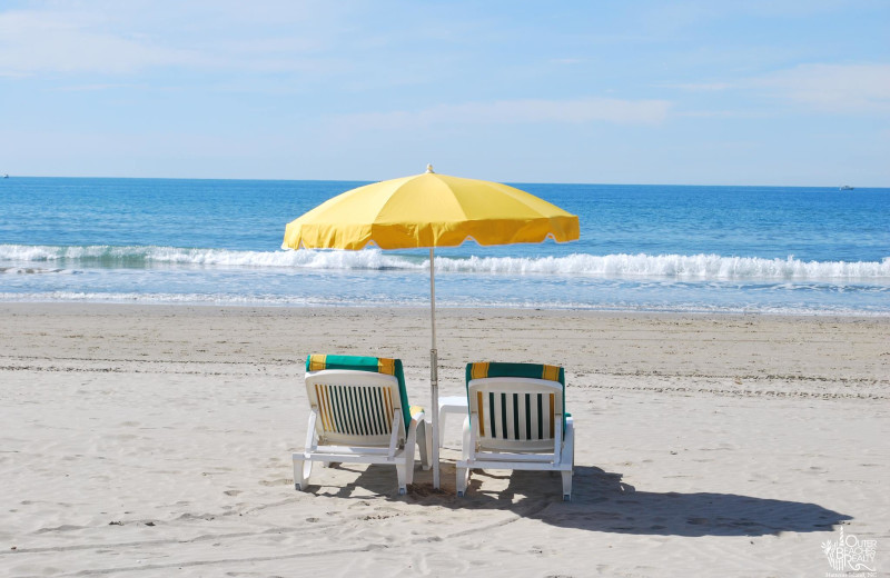 Relax on the beach at Outer Beaches Realty.