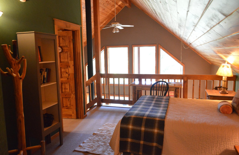 Cabin bedroom at Natapoc Lodging.