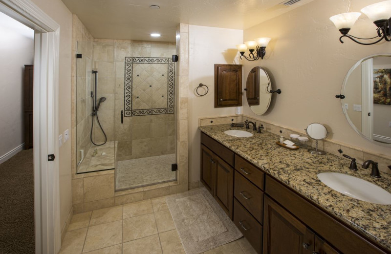 Spacious bathroom at Valentina Suites feature a massage shower with 6 shower heads.