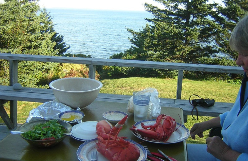 Rental deck dining at Riverview Lobster Pound Cottages.