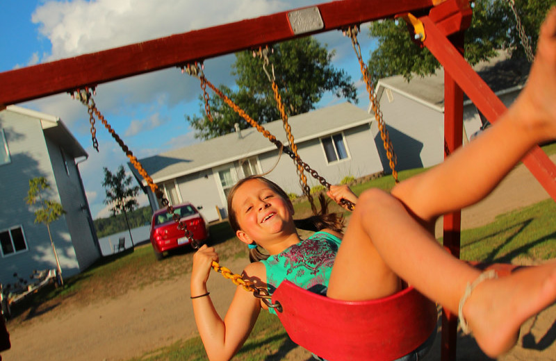 Kid on swing at Auger's Pine View Resort.