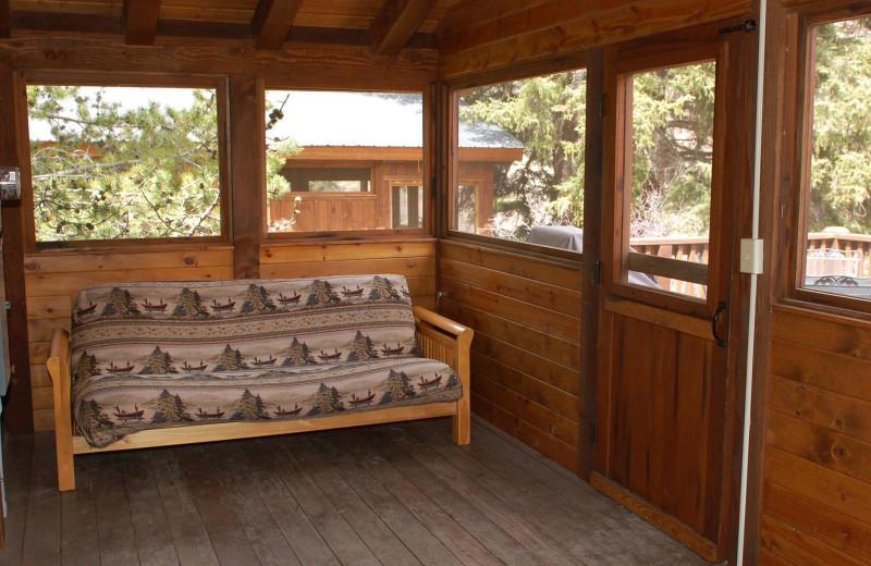 Cabin porch at Three Rivers Resort.