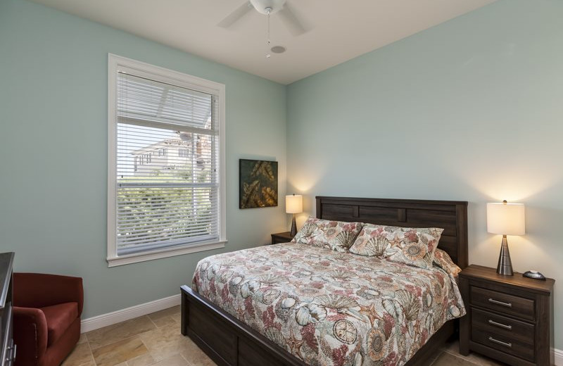 Rental bedroom at Sun Palace Vacation Rentals.