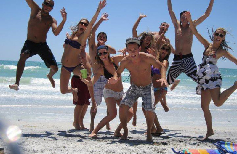 Group on the beach at Gulf Winds Resort Condominiums.