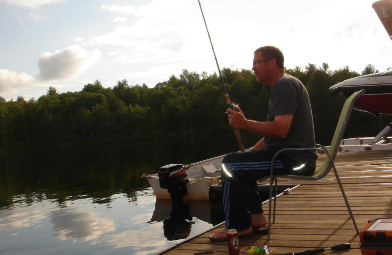 Fishing on dock at Crooked Lake Wilderness Lodge.