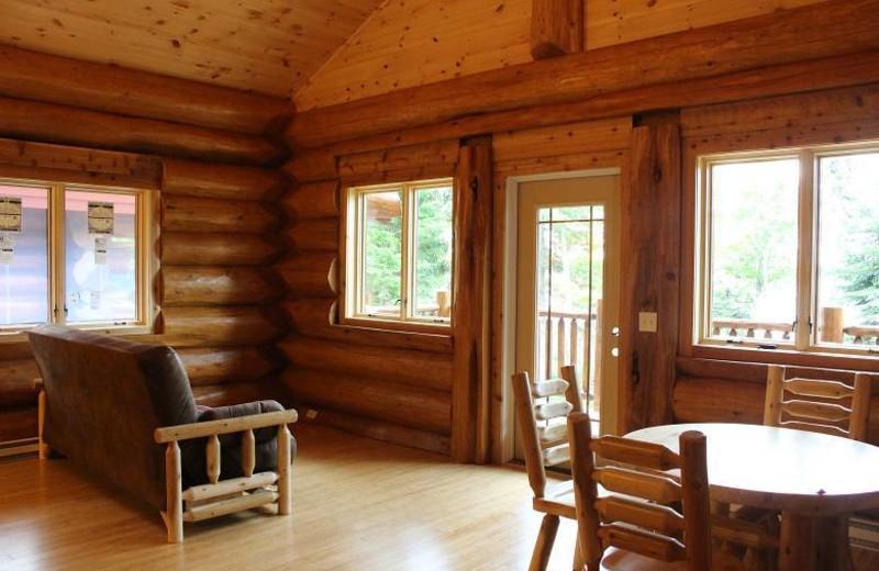 Cabin living and dining area Aqua Log Cabin Resort.