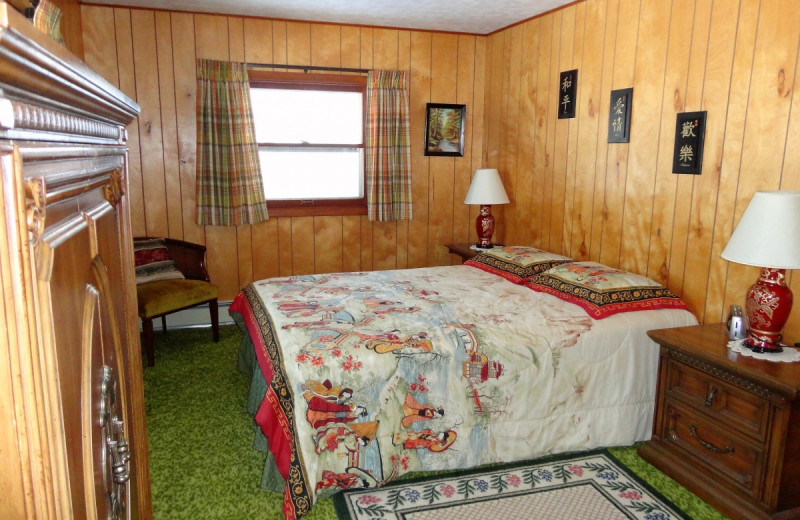 Cabin bedroom at Gypsy Villa Resort.