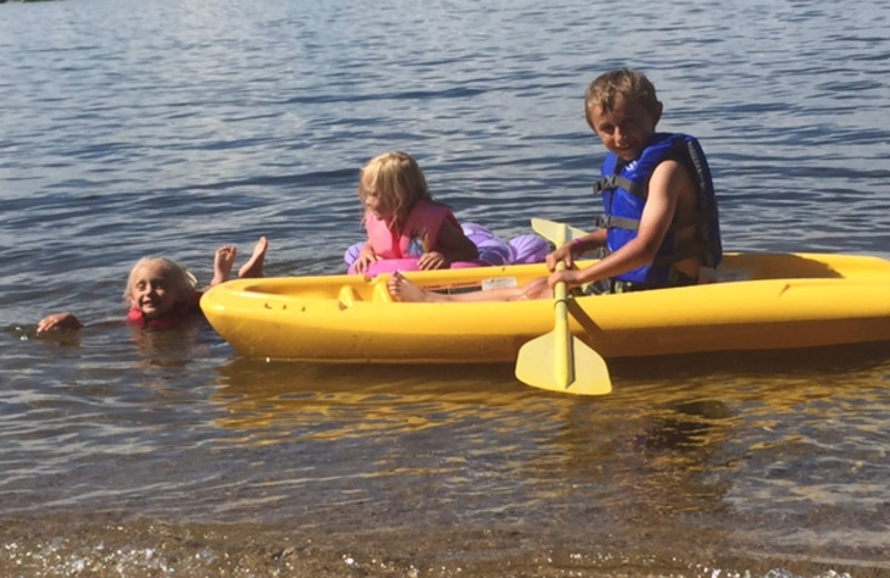 Family on beach at Krueger's Harmony Beach Resort.