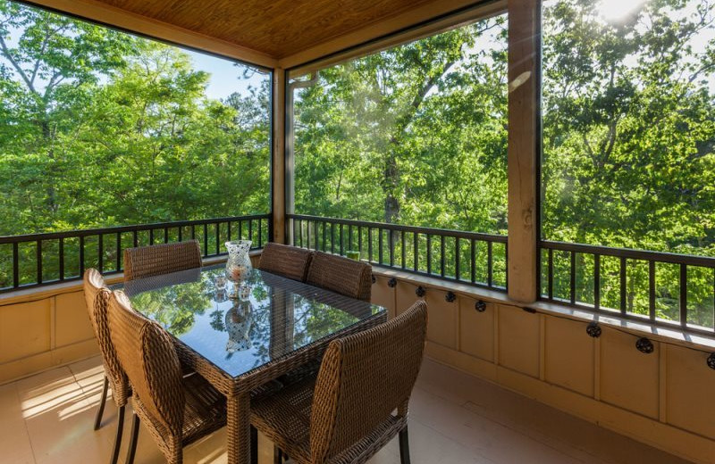 Cabin deck at Mountain Oasis Cabin Rentals.