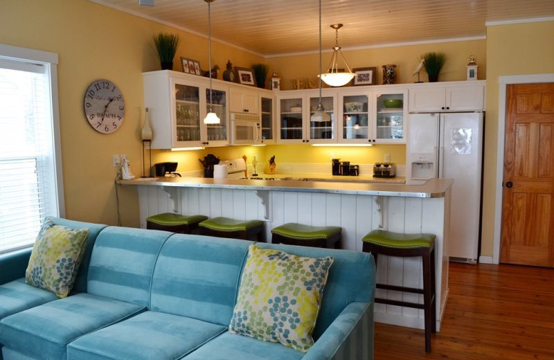 Vacation rental living room and kitchen at Bella Beach Property Management.