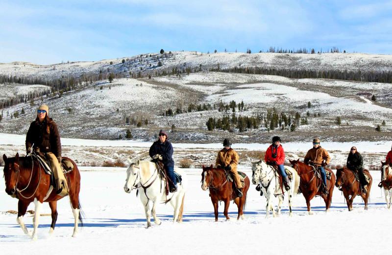 Winter horseback riding at C Lazy U Ranch.