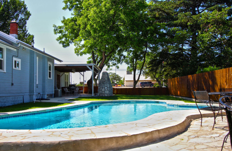 Outdoor pool at Peach Tree Inn & Suites.