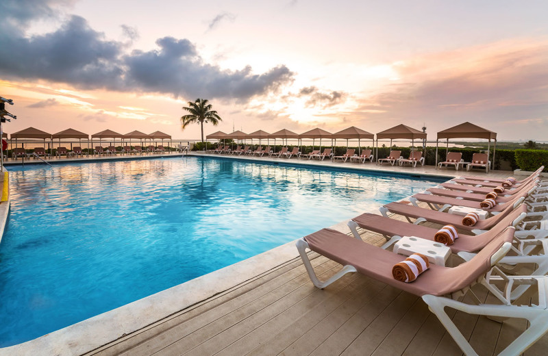 Outdoor pool at Crown Paradise Club Cancun.