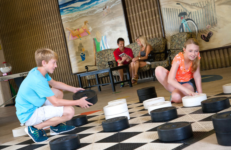 Family playing giant checkers at Ocean Reef Resort.