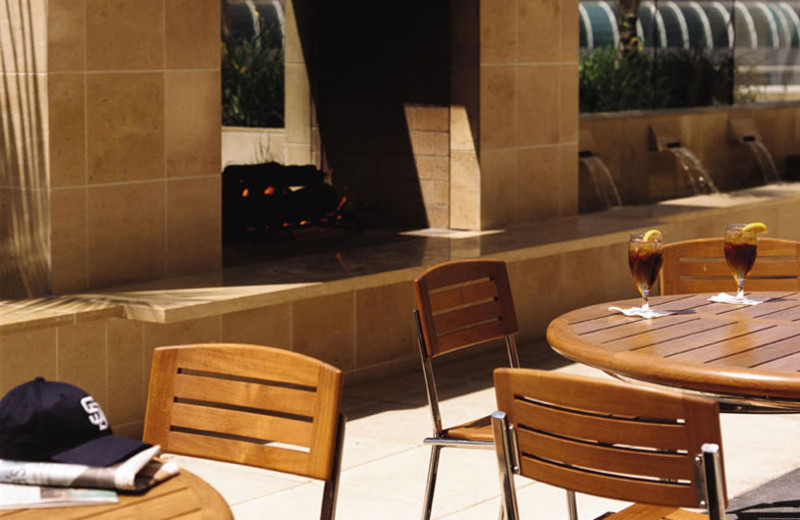 Outdoor dining on Palm Terrace at Omni San Diego Hotel.