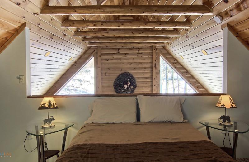 Cottage loft bedroom at Hawk's Eye Golf Resort.