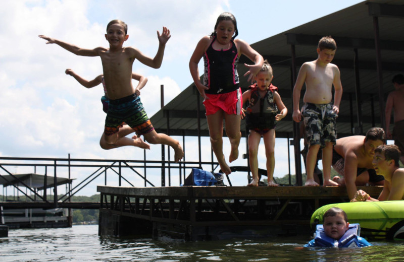 Kids jumping in lake at Point View Resort.