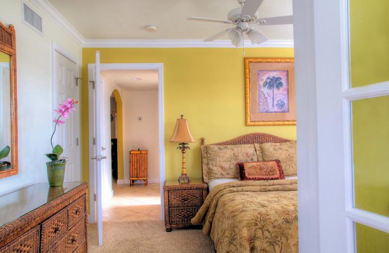 Vacation rental bedroom at Barefoot Beach Resort.