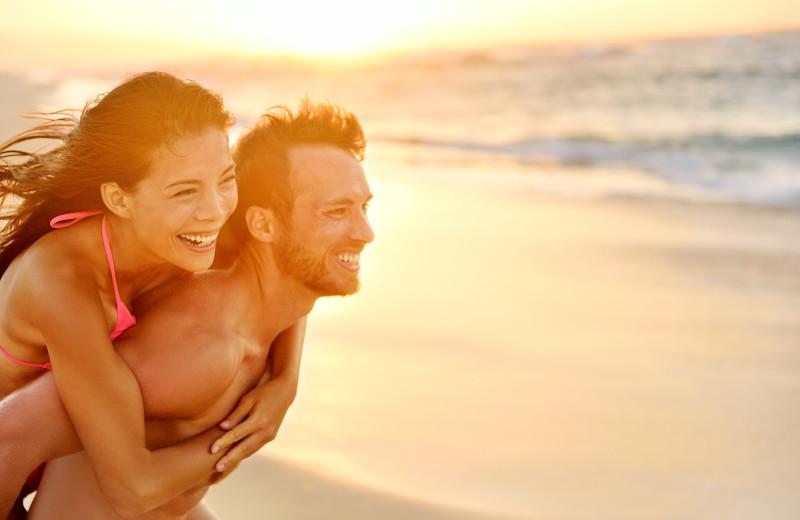 Couple on beach at Joe Lamb Jr. & Associates Vacation Rentals.