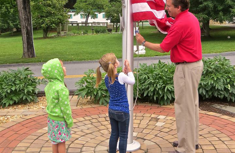 Rising the flag at Capon Springs.