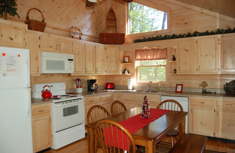 Cabin kitchen at Cuddle Up Cabin Rentals.